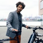 Riese and Muller Homage 2021 - Man riding bike near docks