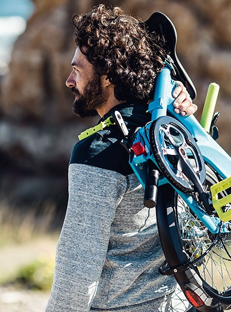 man-carrying-riese-and-muller-birdy-ebike