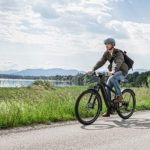 man-riding-onriese-and-muller-delite-ebike